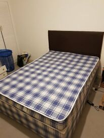 Double bed with spring mattress
