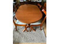 Free Extending wooden dining table and 4 chairs