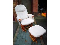 Reclining and rocking nursing chair with footstool.