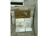 FREE TO UPLIFT cardboard packing boxes