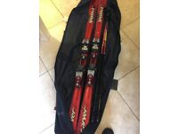 A pair of used red ladies 163cms Volkl Carver skis, with Marker bindings, poles and ski bag