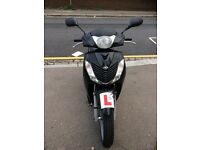Honda sh 125 10 plate black and silver