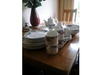 Royal Doulton, Autumn Glory tea set and dinner set. In immaculate condition.