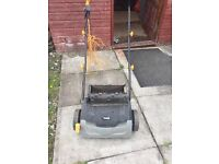 Titan electric lawn scariffier with interchangble drums
