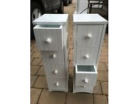 Two small white wood units