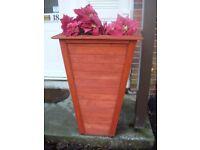 tall wooden garden planter.