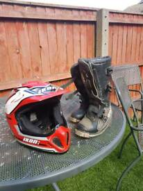 Young boys helmet and boots motor cross