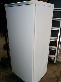 A Tall Indesit White Electric Upright Freezer