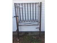 Metal garden gate with posts