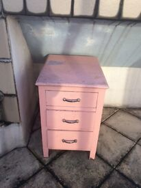 pink wooden cupboard with drawers bedside table storage