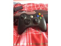 Xbox360 with a few games and one BRAND NEW controller