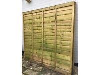 4 fence panels, never used plus 2 3x3 wooden posts.