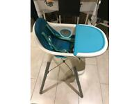 Baby highchair with safety straps and table