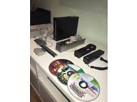 Nintendo Wii with all cables, controller + Nunchuck + 3 Games