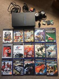 PlayStation 2 with 15 games & accessories