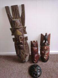 4 carved wooden masks