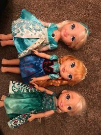 3 frozen dolls. One singing Elsa doll