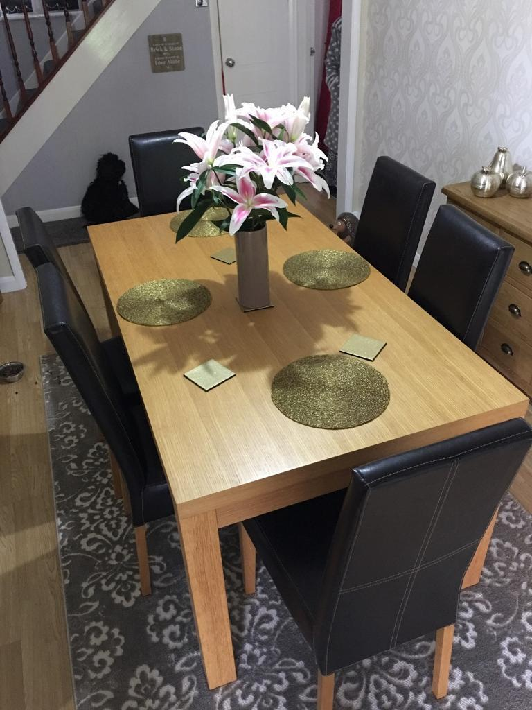 Oak dining table with 6 faux leather chairsin Nottingham, NottinghamshireGumtree - Solid oak dining table with 6 chairs in brilliant condition £100 no offers or time wasters. Thanks for looking
