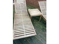 2 wooden loungers and side table