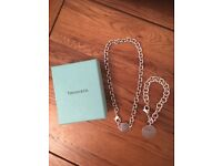 Tiffany sterling silver 'return to Tiffany' round tag bracelet and 'return to Tiffany' necklace.