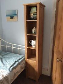 2 X Tall, slim Oak shelving units with cupboard underneath. No veneer. Good condition
