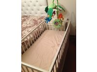 baby cot with bedding and play
