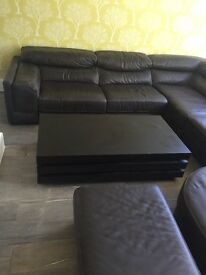 Dark brown leather sofa. U shape, great condition. Includes leather foot stool