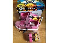 Brand new girls heelys spiffy pink glitter, size 1 with two wheels, great for Christmas
