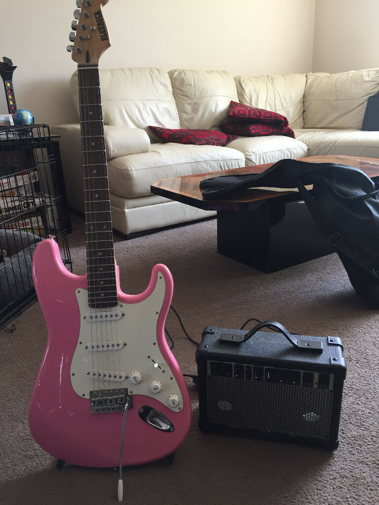Pink Guitar, amplifier, case and stand