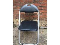 Folding metal chair with navy faux leather seat