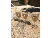 3 dainty gold wine glasses