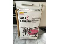 A cycle carrier that fits on the back of the car and carries up to 3 bikes