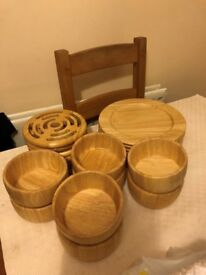 Beautiful wooden plate chargers with matching bowls, and trivets - Immaculate