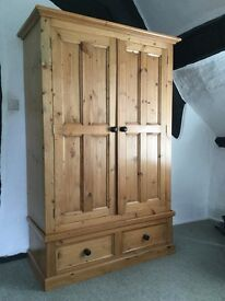 "Solid pine wardrobe in vg condition. 45""x74""x21"""