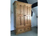 "Solid pine wardrobe in vg condition. 45""x74""x21"""