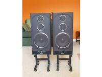 Pair of Aiwa loudspeakers with floor stands.