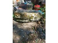 Solid log style planter garden pot