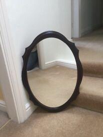 1A mirror in dark wood