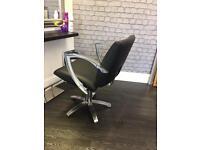 Black hairdressing chair