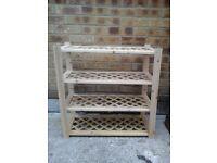 Light wood lattice shelved storage unit