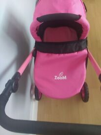 Dolls pram with car seat and and stroller attachment.