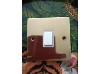 Polished brass light switch