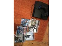 Sony playstation PS3 plus 2 controllers, and games