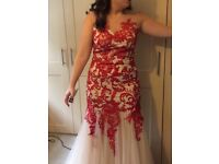 Beautiful Prom dress, only worn for 3 hours corsage and hair piece also .Nude and Red