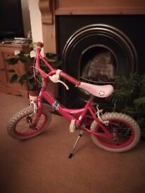 Childs's pink bicycle