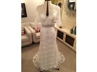 Size 10-12, Bridal dress, Satin & lace, open back, mid sleeve, embellishment and train at back.