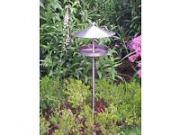 Stylish stainless steel contemporary bird table/feeder