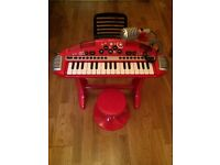 Red and black Early Learning Centre keyboard & stool with microphone - child's toy.