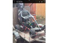 Electrokart golf buggy and trailer.