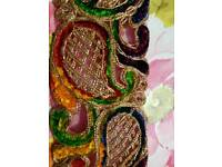 Multi coloured velvet & gold lace.